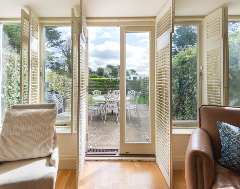 Attractive cream shutters can be closed in the evenings or if the Cornish sunlight proves to strong at anytime at Lowenna Manor 5, a self catering, holiday house to rent in Rock.
