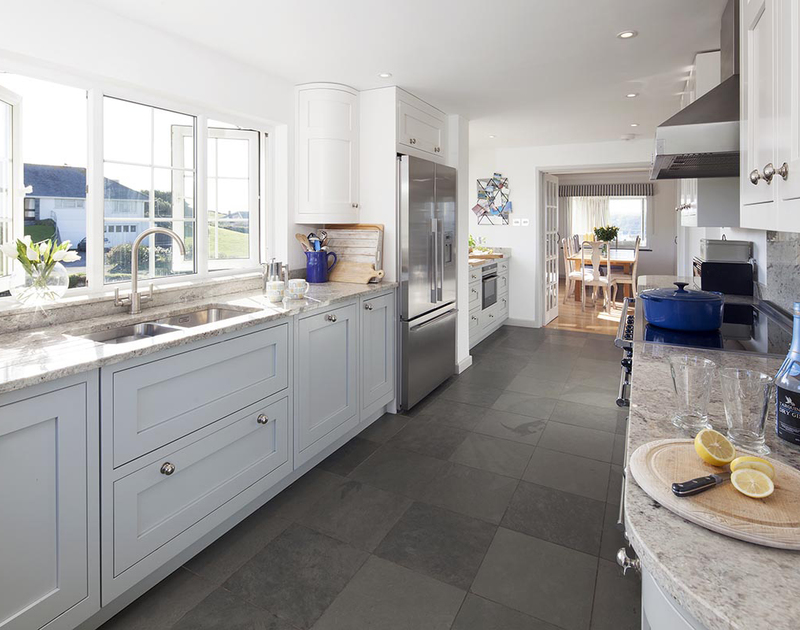 Sunshine spills into the large kitchen at Spindrift with its beautiful fitted cabinets topped with marble work surfaces