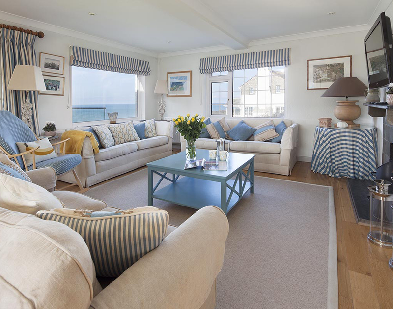 Cosy up by the fire in the comfortably and stylishly furnished living room at Spindrift near Daymer Bay, to enjoy the wonderful sea views.