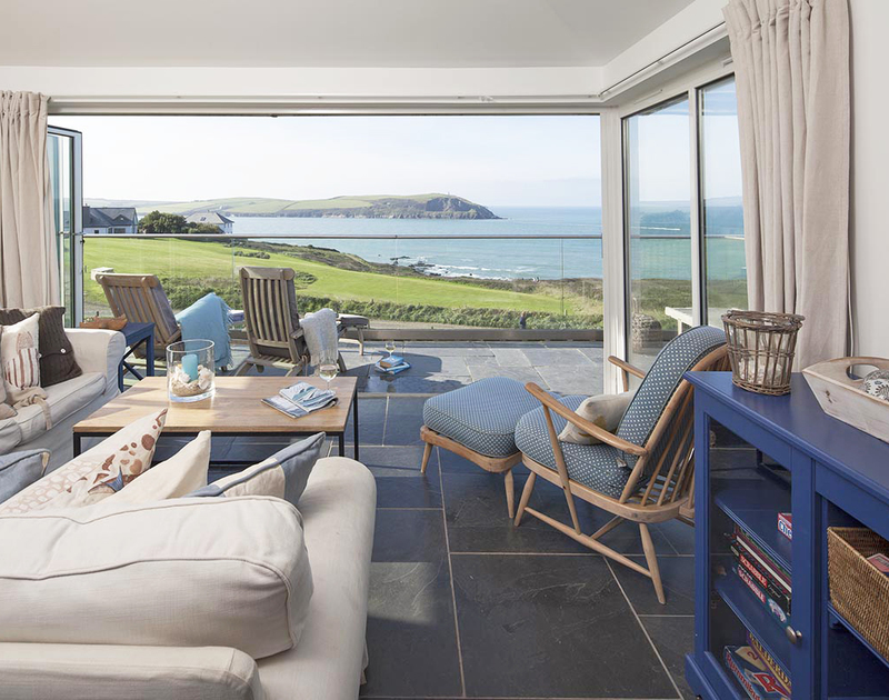 The sun lounge at Spindrift, a self-catering holiday house near Daymer Bay, offers panoramic sea views of the Atlantic Ocean in North Cornwall