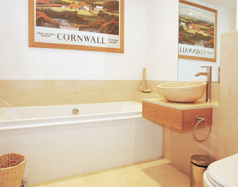 Luxurious bathroom at Spindrift, a holiday house near Daymer, with contemporary wash basin.