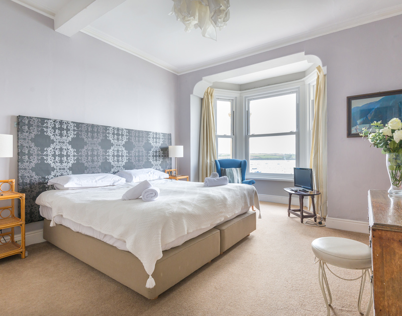One of the beautiful bedrooms with sea views in 4,The Terrace, a waterfront self catering holiday house on the Camel Estuary in Rock, Cornwall.