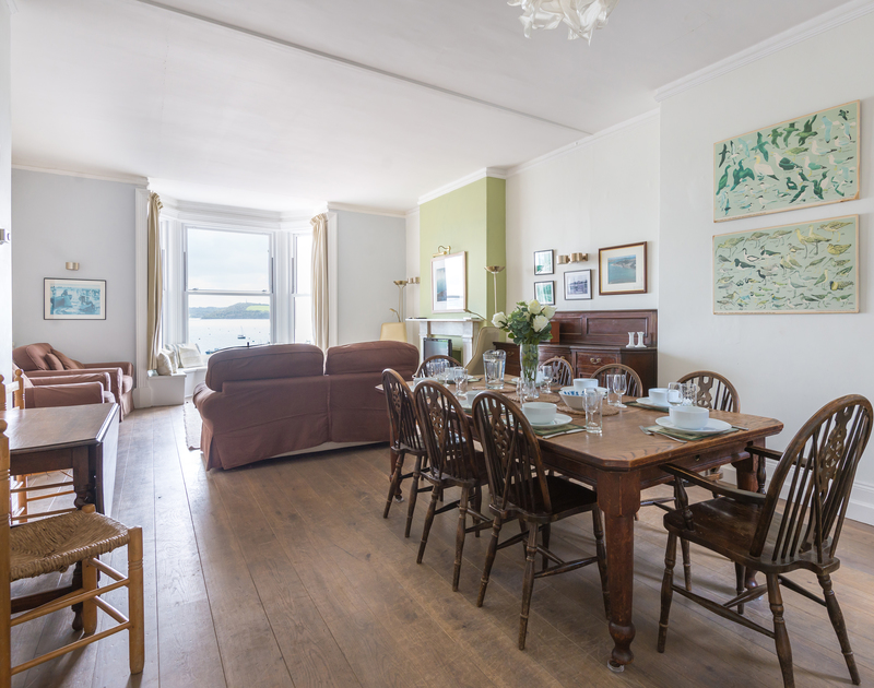 The bright open plan dining/living room in 4, The Terrace, a holiday house to rent on the waterfront of Rock's beautiful Camel Estuary in Cornwall.