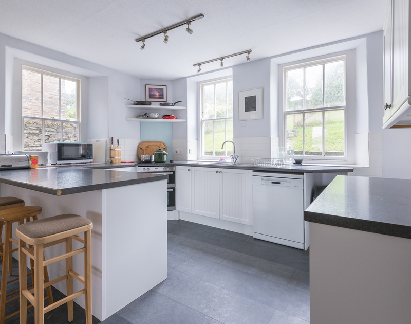 Light fills the well equipped kitchen at 4, the Terrace, a stunning, self catering, family, holiday property in one of the best spots on the Camel Estuary in Rock.