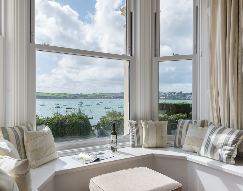 A picture postcard view of the boat moorings from the bay window at 4, The Terrace, a beautiful, Victorian holiday property in the very hub of Rock on the Camel Estuary.