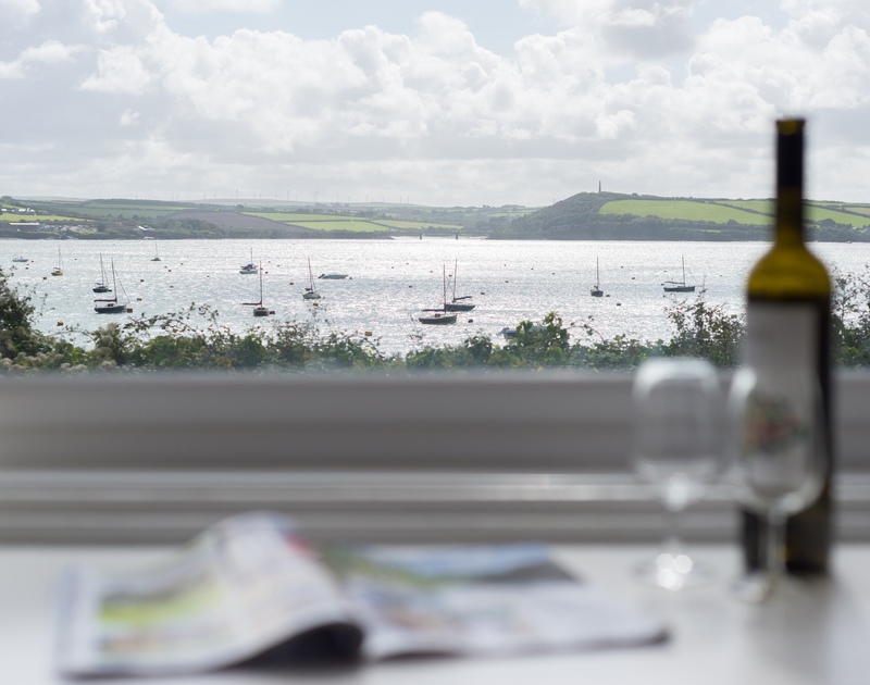Sip an evening drink from the comfort of 4, The Terrace and enjoy the views over the moorings at Rock out towards the iron bridge spanning the old railway line on the Camel Trail.