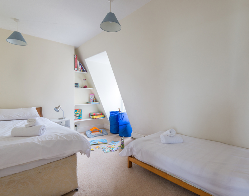 A twin bedroom at 4, The Terrace, a large Victorian, family holiday house to rent on the Camel Estuary in Rock, North Cornwall.