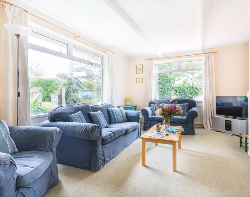 The comfortable sitting room in Avoca, a self catering holiday rental in Rock, North Cornwall.