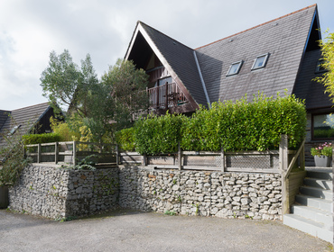 The chalet style exterior of 8 Sandy Hills, holiday accommodation in Rock, with wooden decking