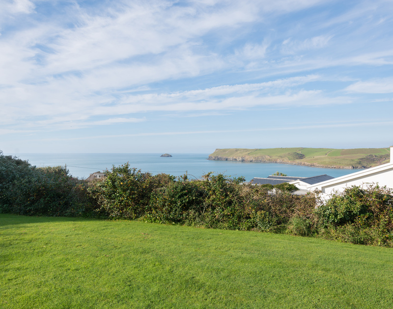 Enjoy the unspoilt views of the sea, skies and the magnificent headland at Pentire Point from the lawned garden at Trewint in Polzeath, Cornwall.