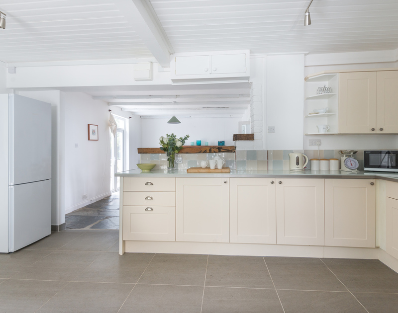The kitchen and dining room are open plan at Signal Post, a self catering holiday house in Port Isaac on the North Cornish Coast.
