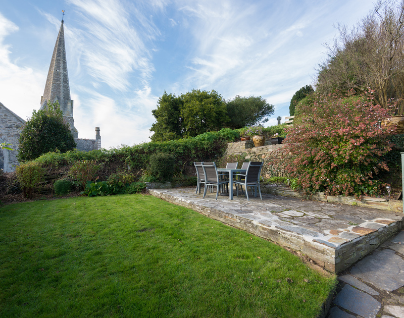 The garden and slate terraces at Honeysuckle Cottage available for self catering holidays on the north Cornish coast.