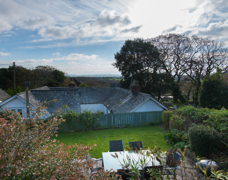 There are fantastic rural views from the top of the garden at holiday rental, Honeysuckle Cottage in St Minver.