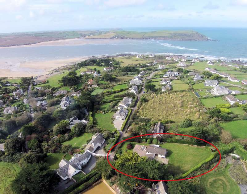 An aerial view of self catering Tringa and its large gardens set in close proximity to the beautiful Camel Estuary in north Cornwall.