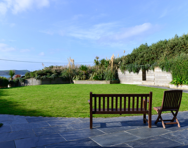 Have a seat in the well maintained garden at Clouds Hill and enjoy the stunning backdrop of the sea, sky and Stepper Point beyond.