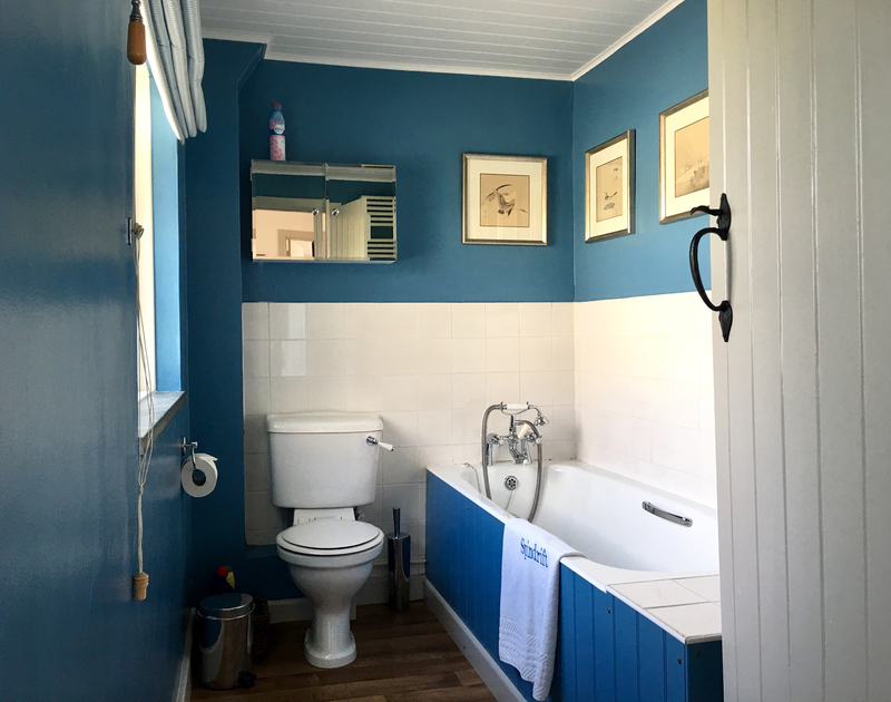 The sea inspired family bathroom is set on the first floor at Spindrift, a large coastal holiday house in North Cornwall