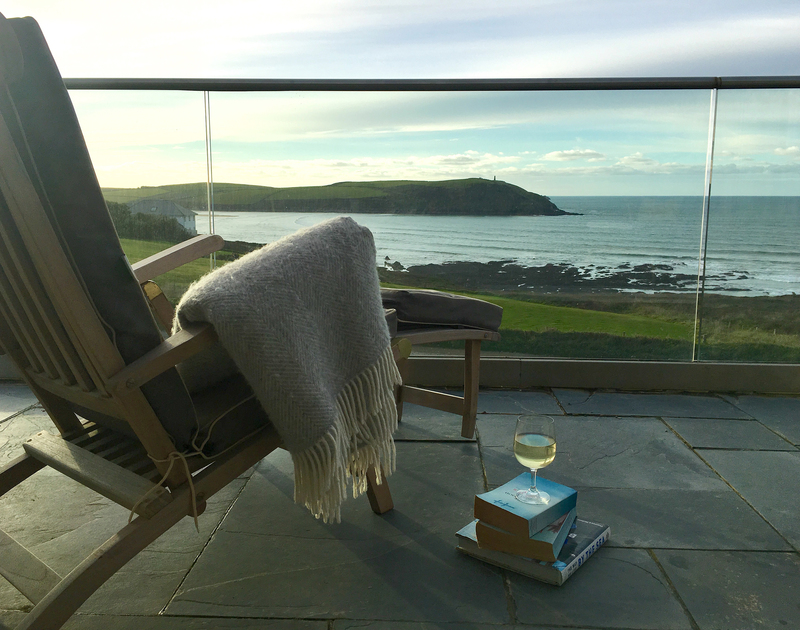 Cuddle up under a blanket and watch the sunset over the Atlantic from the balcony at Spindrift in North Cornwall