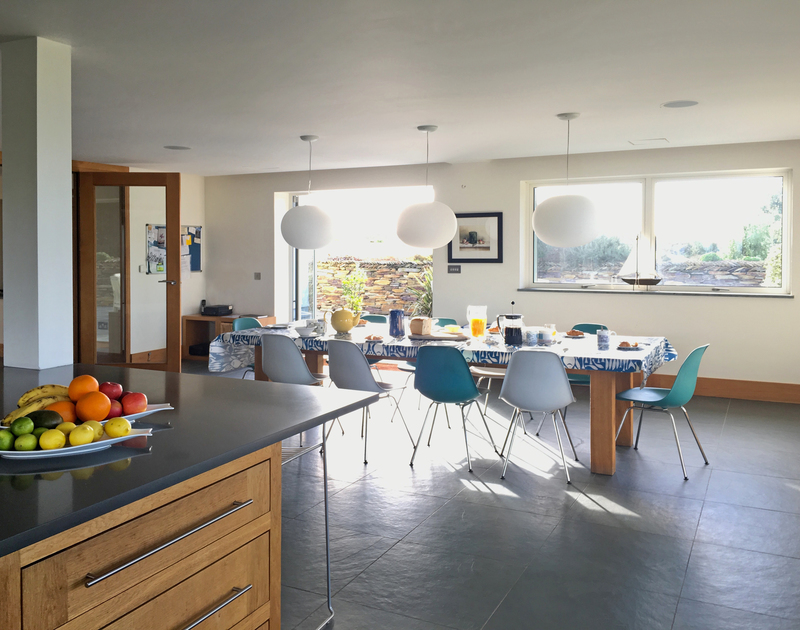 The large open plan kitchen dining room at Greenaway Reach opens up to the side patio