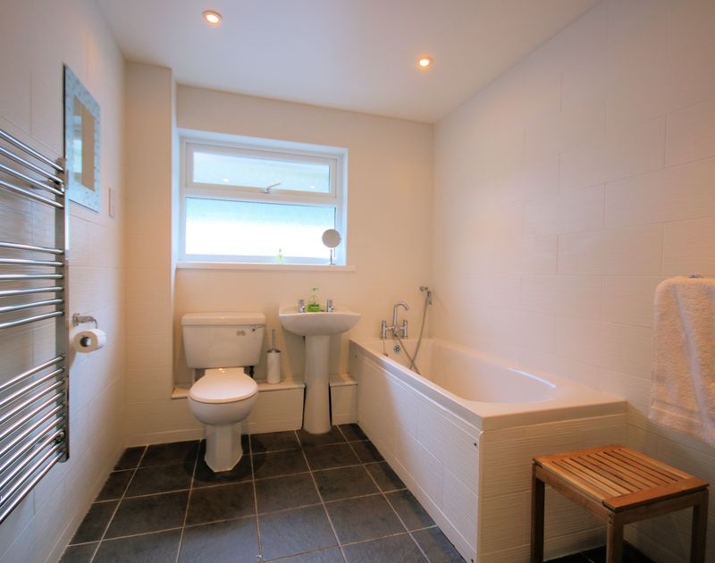 The family bathroom at Stradav, a self-catering holiday house in Polzeath, Cornwall