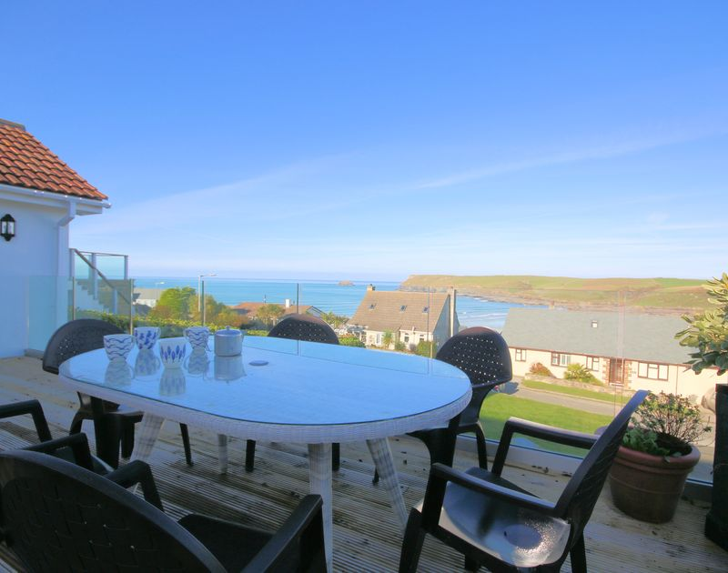 Beautiful views over the sea and out towards Pentire Point from the decked balcony at Stradav in Polzeath, Cornwall.