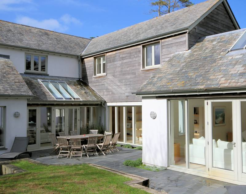 Self catering Church Lane House is a beautifully designed holiday home with white walls, blue/grey slates and wood cladding with lots of large glass doors and windows to enable lots of Cornish light to flood in.