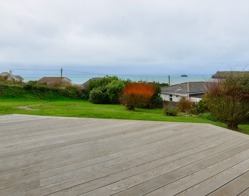 The garden and large, wooden decked terrace provides plenty of lounging space to appreciate the panoramic sea views from Sea Mist in Polzeath.