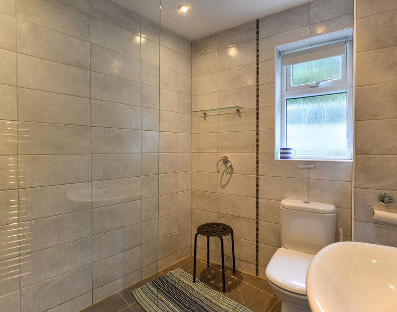 Fully tiled shower room at Sea Mist, a self catering holiday property with panoramic views set above the cliffs at Polzeath in North Cornwall.