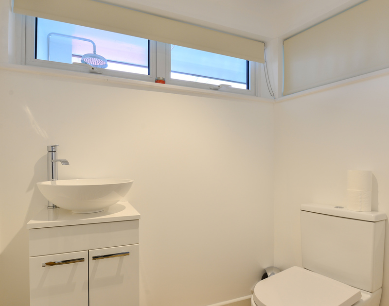 One of three bathrooms at self catering holiday house Sea Mist set above the beach at Polzeath with fabulous sea views.
