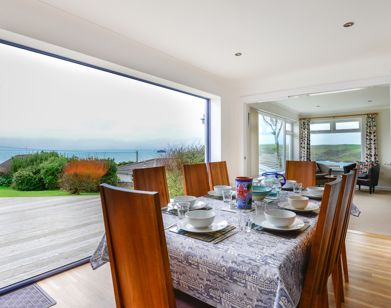 Sea Mist is a stylishly renovated holiday house with panoramic sea views over Polzeath, the dining room benefits from vast, glass patio doors.