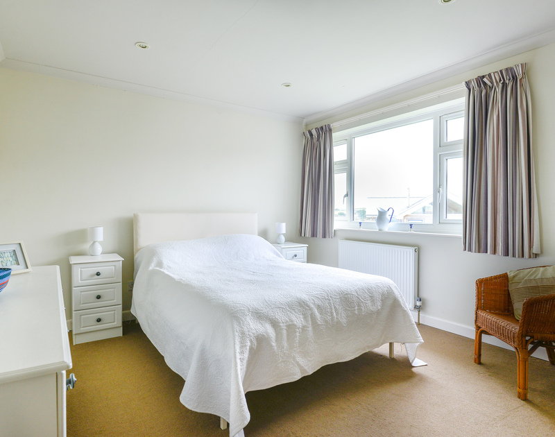 The double bedroom at Sea Mist a well positioned coastal holiday house to rent in Polzeath, North Cornwall.