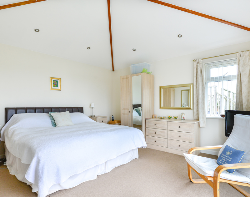 The light, spacious master bedroom at Sea Mist enhanced by the high, feature ceiling.