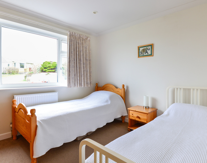 One of two twin bedrooms at seaside, self catering holiday property Sea Mist in Polzeath, North Cornwall.