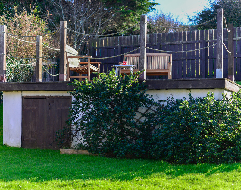 Relax and enjoy the setting of Silvershell House in Port Isaac  from the raised decking area in the garden.