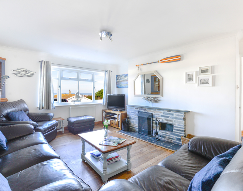Plenty of comfortable seating in the sitting room at Silvershell House, a self catering, well appointed holiday bungalow in Port Isaac, North Cornwall.