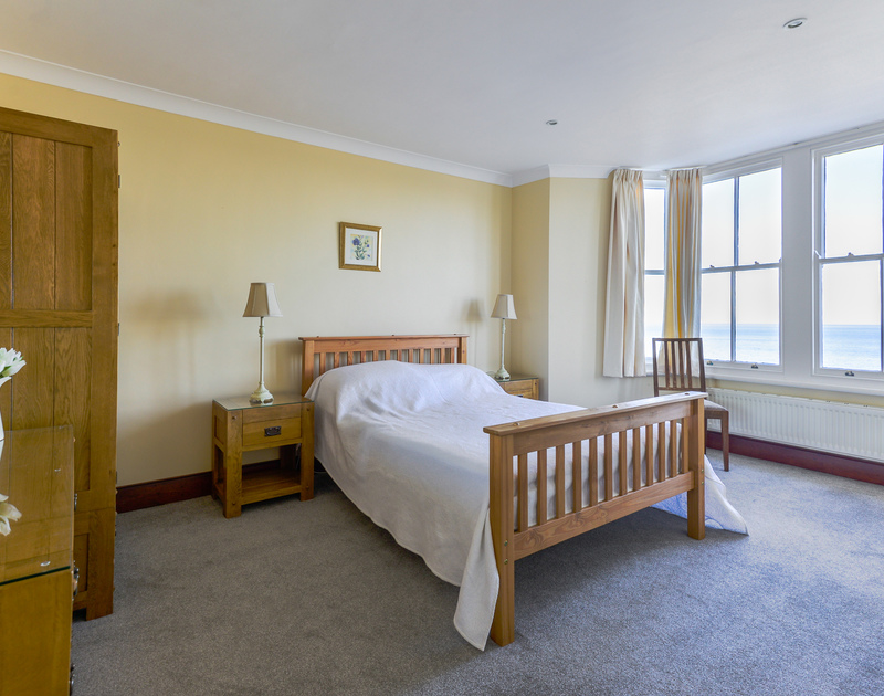 One of the spacious double bedrooms at Seaward with an ensuite and glorious sea views set just above the cove at Port Gaverne in Port Isaac.