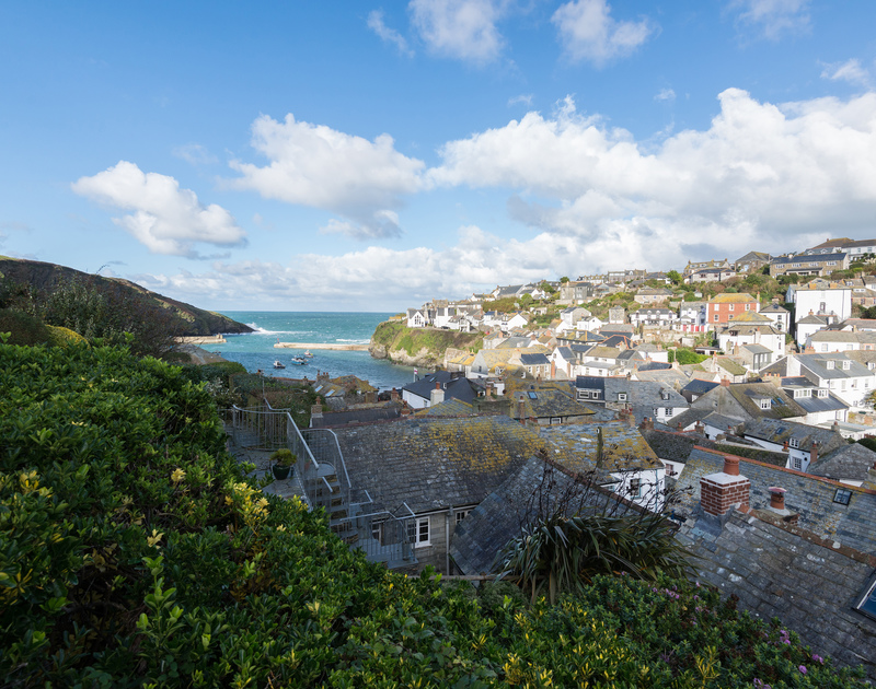 Views over the slate rooftops of Port Isaac and out towards the harbour mouth from the terraced garden at self catering holiday cottage Scuppers.