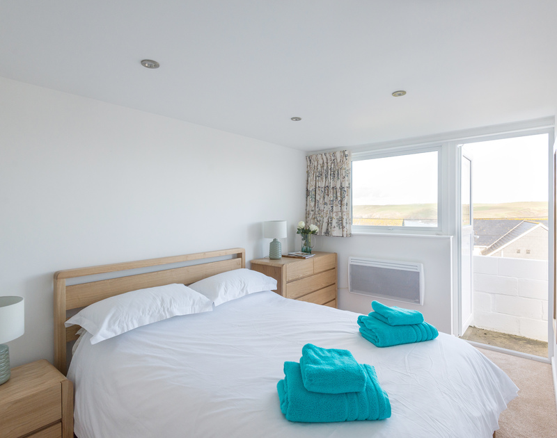 The double bedroom at self catering, holiday house Trelorna with an external door in Polzeath.
