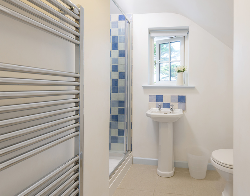 A large heated towel rail in one of the ensuite shower rooms at self catering, Trewidden in Trebetherick.