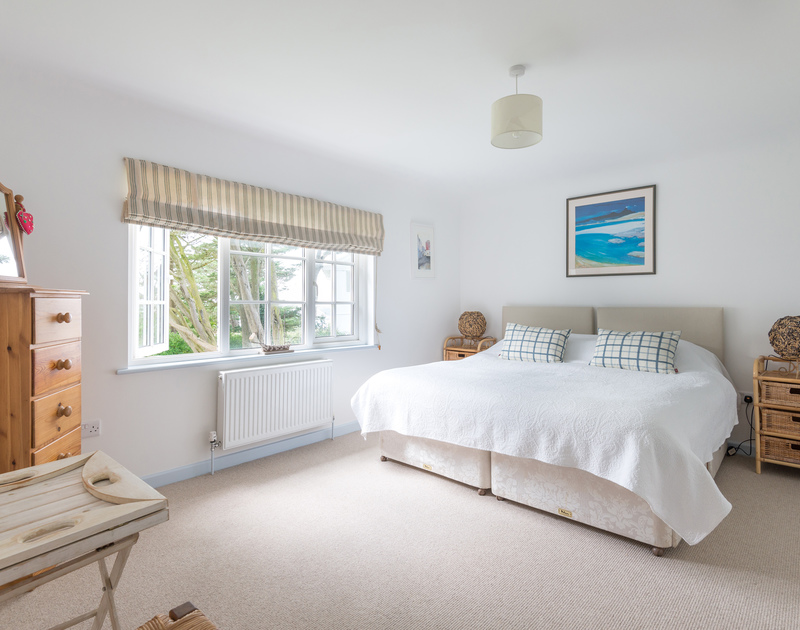 The spacious super king bedroom in Trewidden, a self catering holiday house to rent in Daymer Bay, on the North Coast of Cornwall.