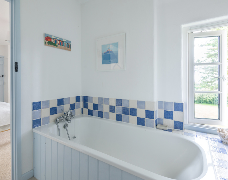 A bathroom in Trewidden, a self catering, dog friendly, holiday house to rent in Daymer Bay in North Cornwall.