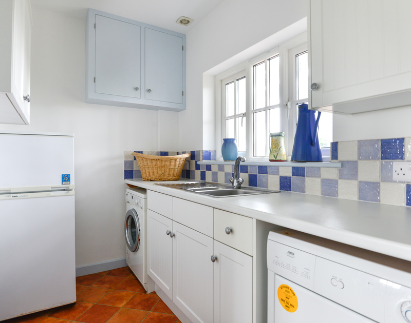 Well appointed utility room at holiday property Trewidden,.
