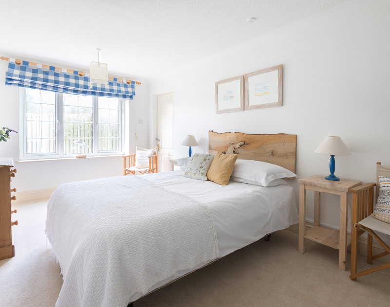 An spacious, ensuite double bedroom at Trewella, a self-catering holiday house at Daymer Bay, Cornwall