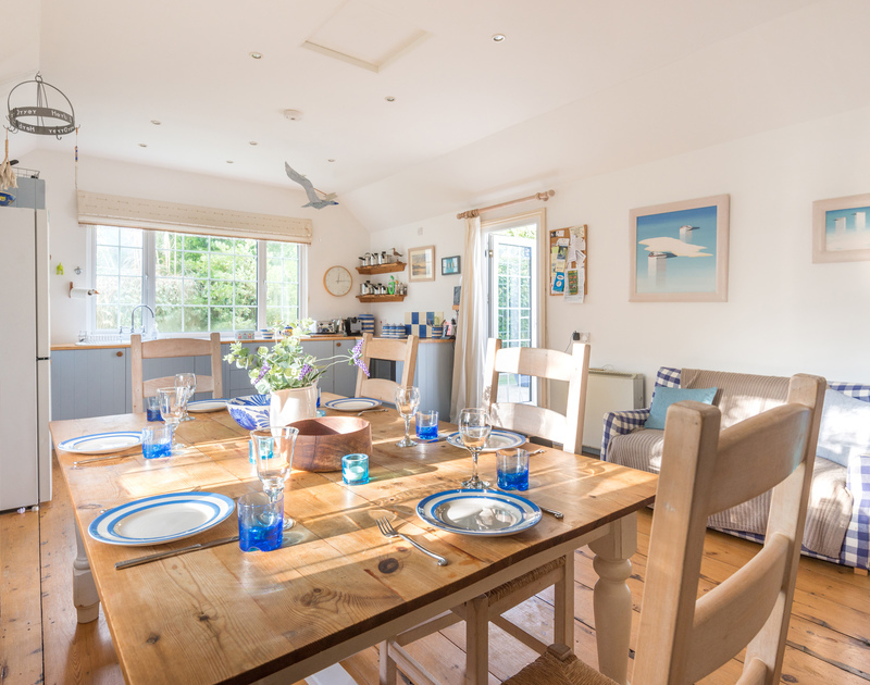 The large, welcoming kitchen/diner of Trewella, a self-catering seaside holiday house at Daymer Bay, Cornwall