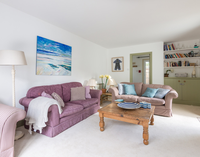 A quiet space to relax, the living room at Trewella, a contemporary holiday home in Daymer Bay on the North Cornwall coast.