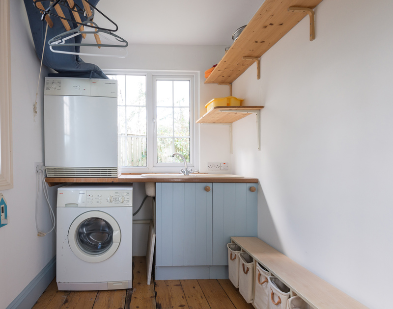 The utility room with plenty of hanging space at Trewella, a self catering, holiday house to rent at Daymer Bay in North Cornwall.