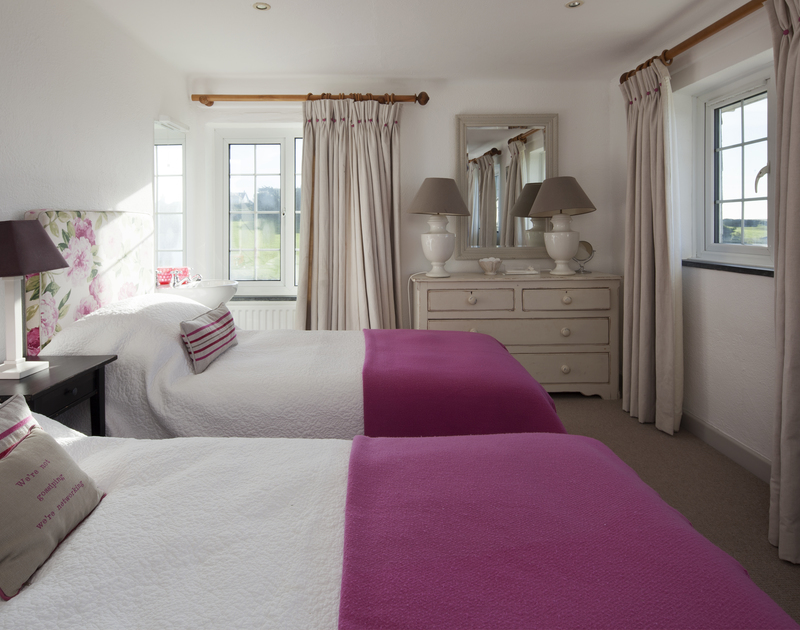 The first floor bedrooms at Spindrift all offer flexible twin beds and hand basins, with wonderful sea views