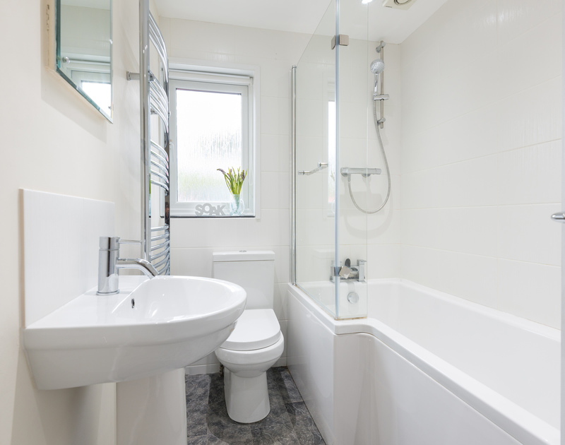 The practical bathroom with a large heated towel rail at Bedrawle, a holiday house to rent in Rock, Cornwall