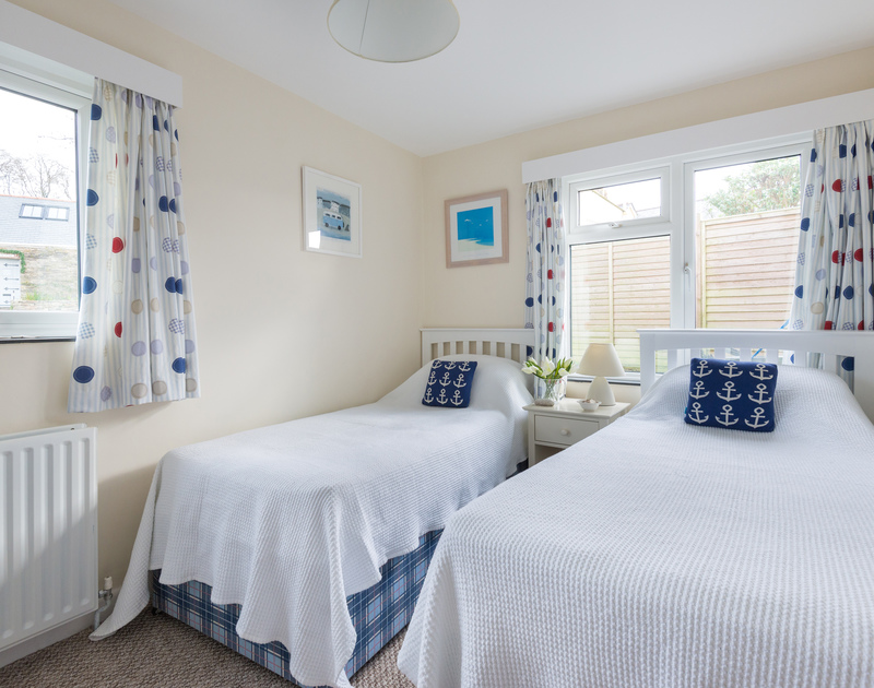 One of three twin bedrooms at Bedrawle, a self-catering, practical holiday house in Rock, Cornwall