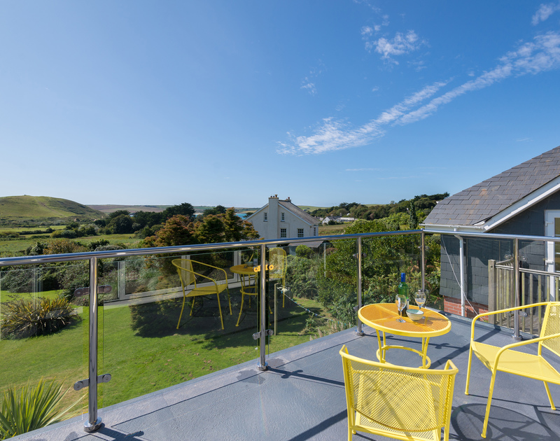 Enjoy breakfast out on your private balcony from the king bedroom at Hob House.