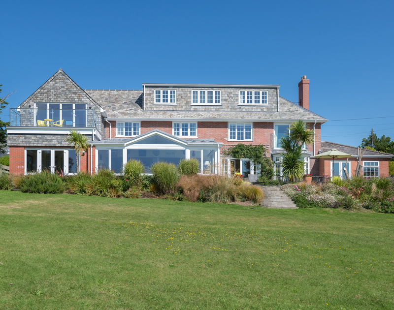 Garden view of Hob House, a large holiday house to rent at Daymer Bay, North Cornwall, with its spacious terrace.